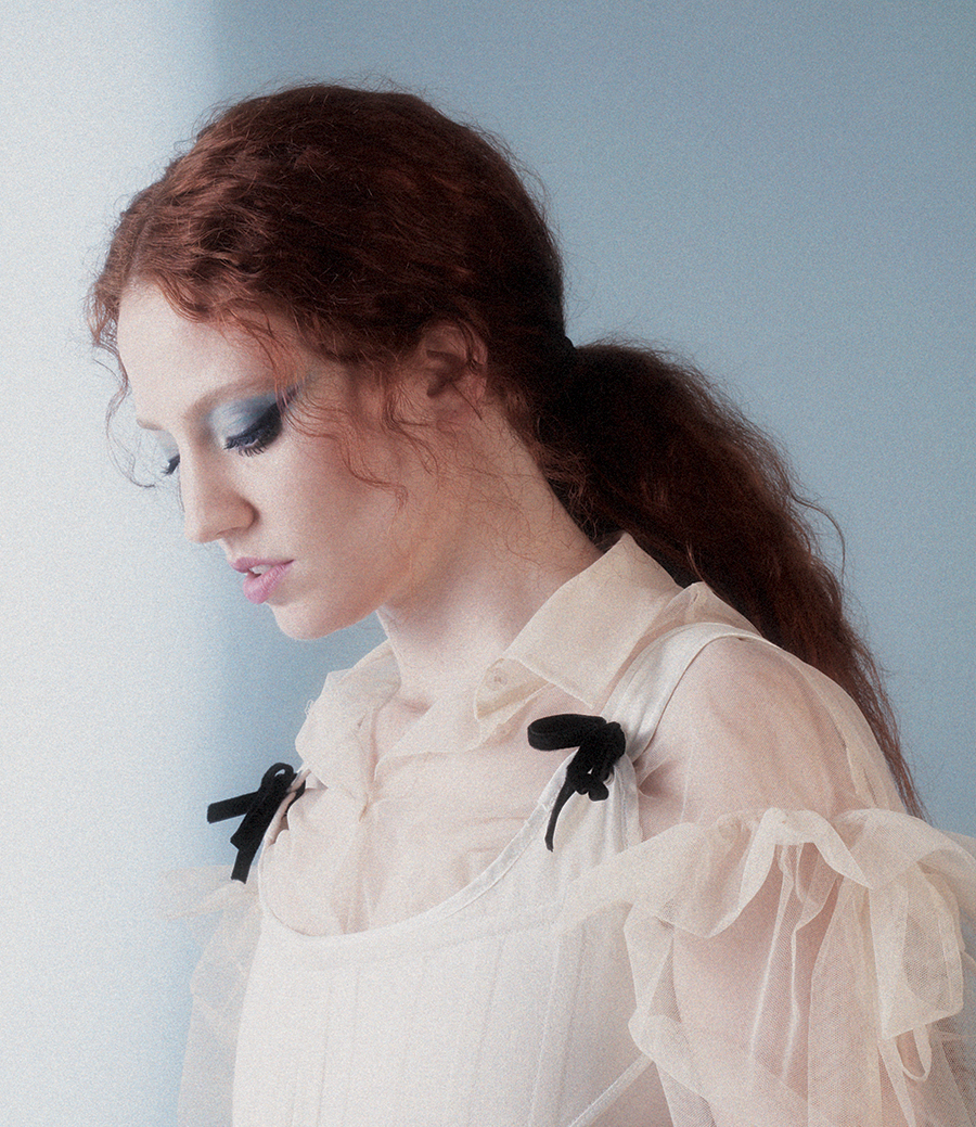 Cream ruffle shirt:  Simone Rocha /  Corset:  The National Theatre Costume Hire
