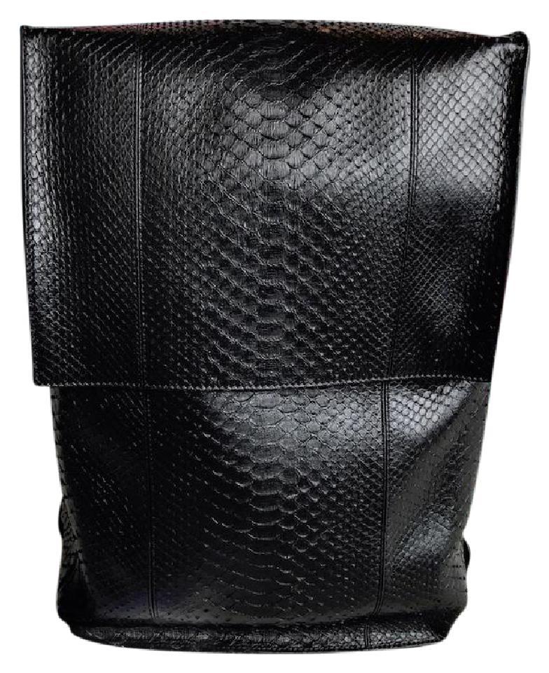 BALENCIAGA    Snakeskin Phileas Backpack, $2,014.95, tradesy.com