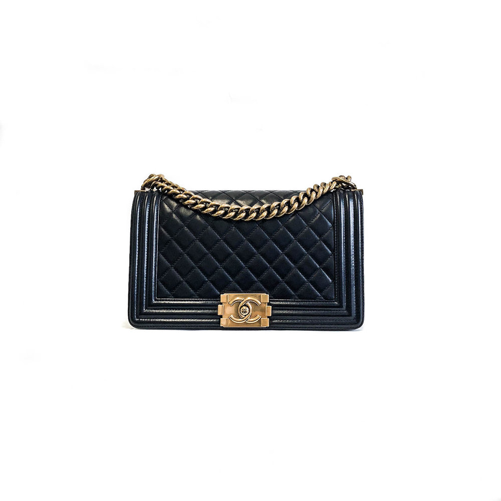 - CHANEL Old Medium Pearly Black Boy Bag in Lambskin Leather; $5,650.00 CAD