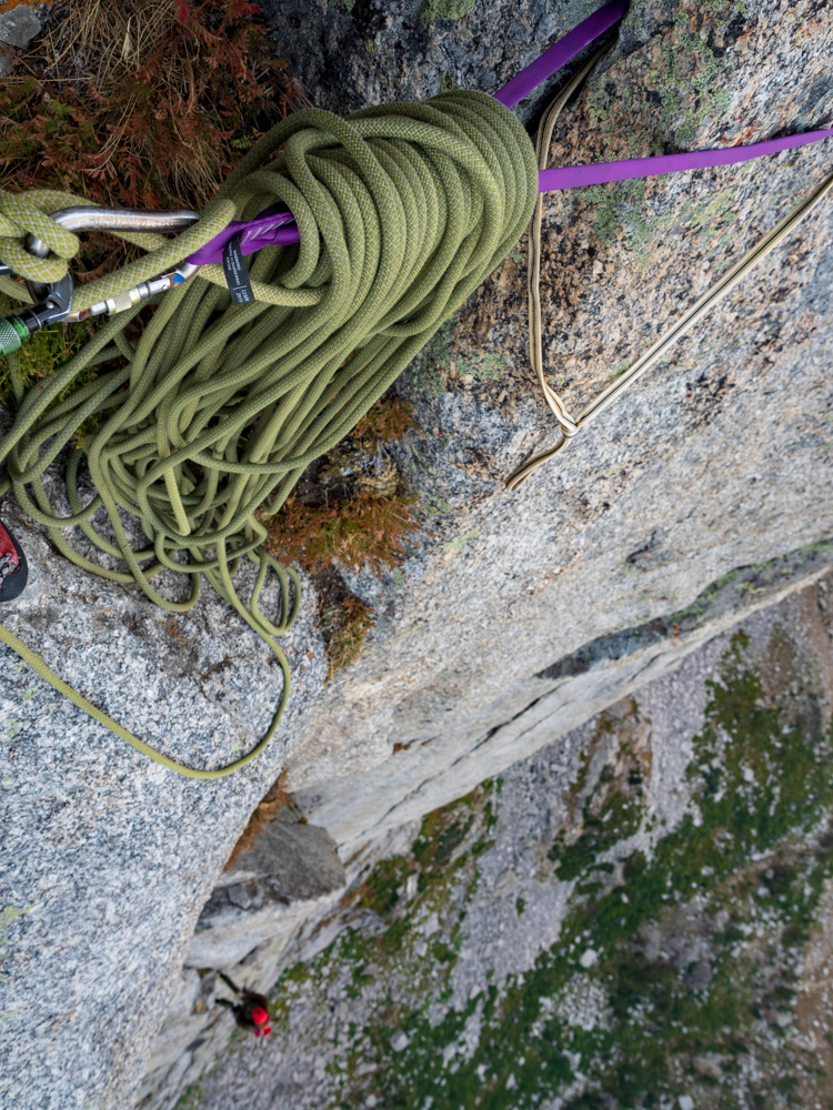 Stacking the rope at one of the belay ledges while Matt works on getting out the protection.