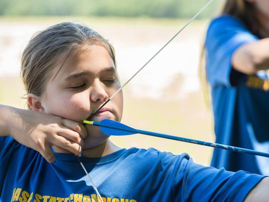 Mackenzie Bennett, 11, of Eden, draws her bow during a practice session on Friday, June 9, 2017. Bennett placed eighth in the nation for her efforts during the championship.