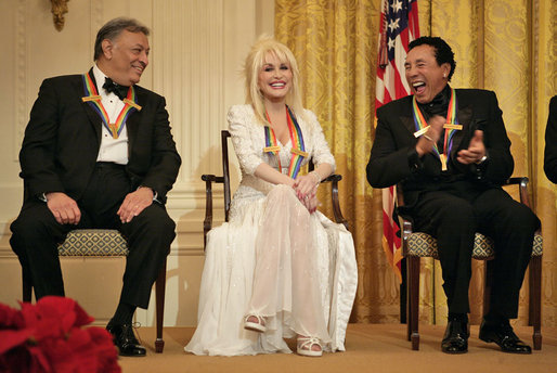 Zubin_Mehta_laughs_with_singers_Dolly_Parton_and_William_Smokey_Robinson_during_a_reception_for_the_Kennedy_Center_honorees.jpg