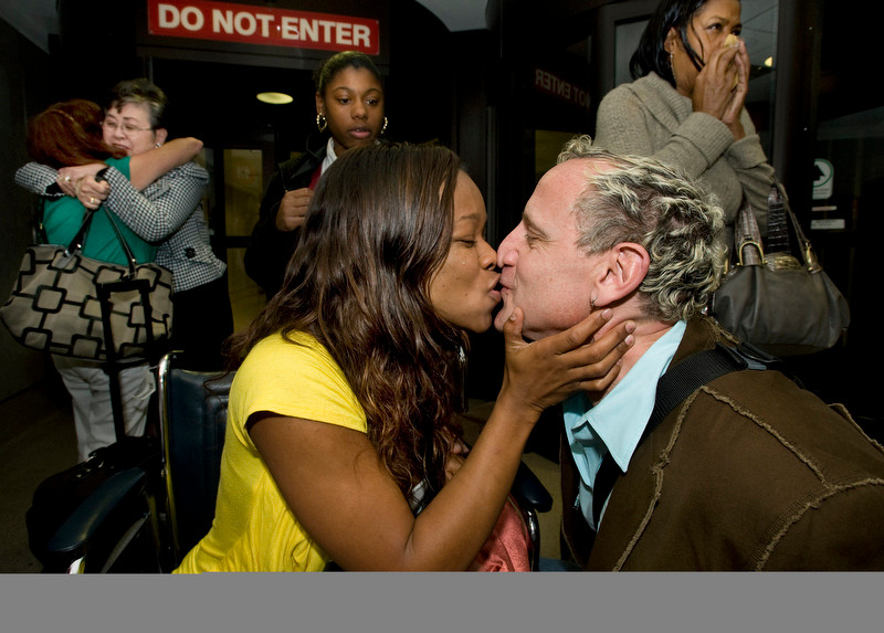 A tearful Aahmes Kubicki gives husband Marty Kubicki a kiss at the customs corridor after arriving home from Haiti Sunday. She was with a group of 10 missionaries from Mission Viejo Christian Church who was in Port-Au-Prince when the 7.0 earthquake hit. Kubicki suffered an injured foot.