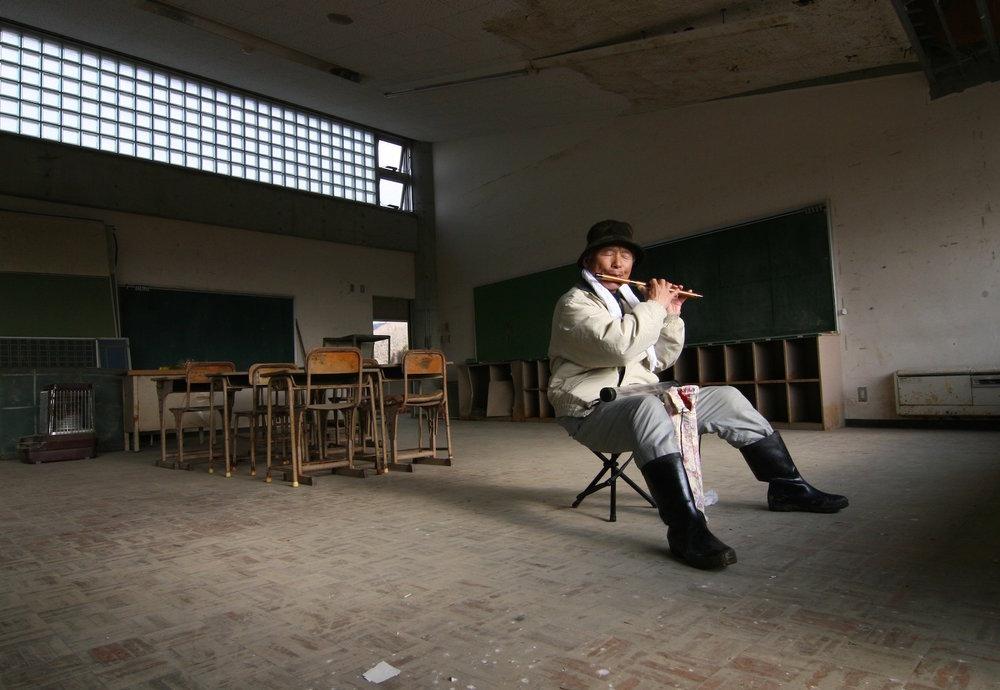 Flute player, Ishinomaki, Japan