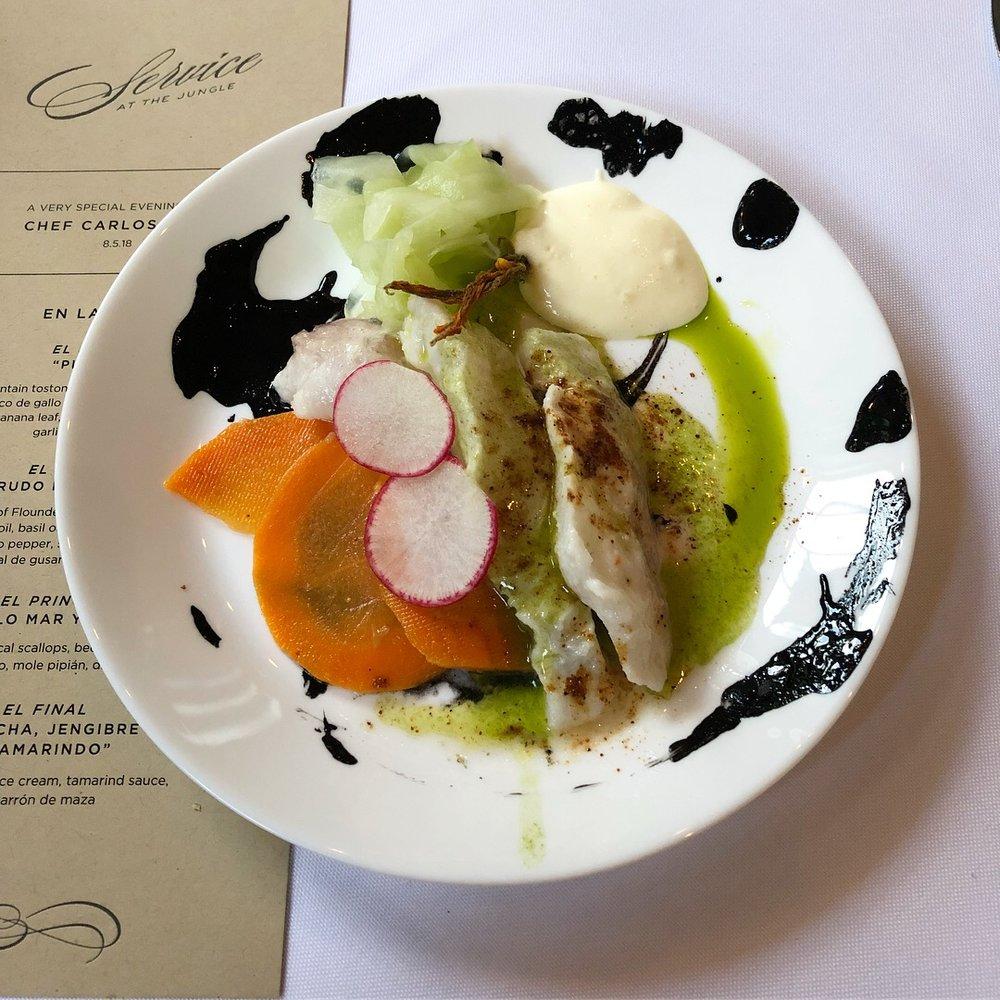 Crudo of flounder, squid ink, citrus juice, cilantro oil, basil oil, pepino, carrot, radish, serrano pepper, sunflower mayonesa, worm salt