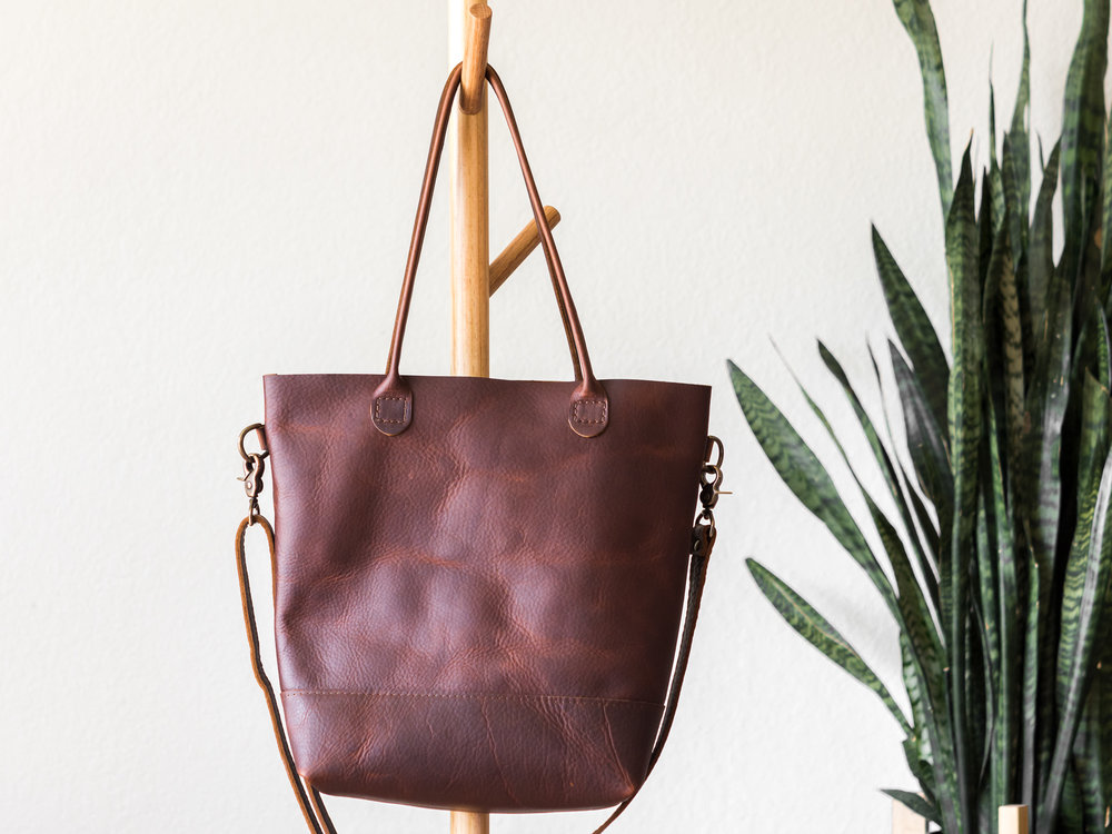 rolled handle tote with crossbody strap in brown.jpg