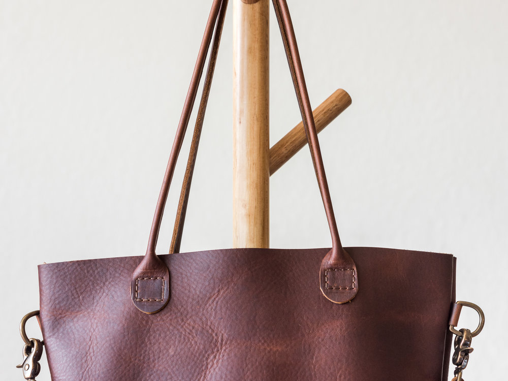 rolled handle tote with crossbody strap in brown1.jpg