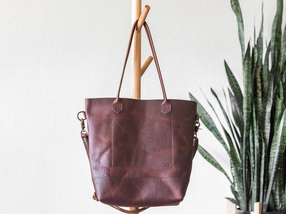 rolled handle tote with crossbody strap in brown2.jpg