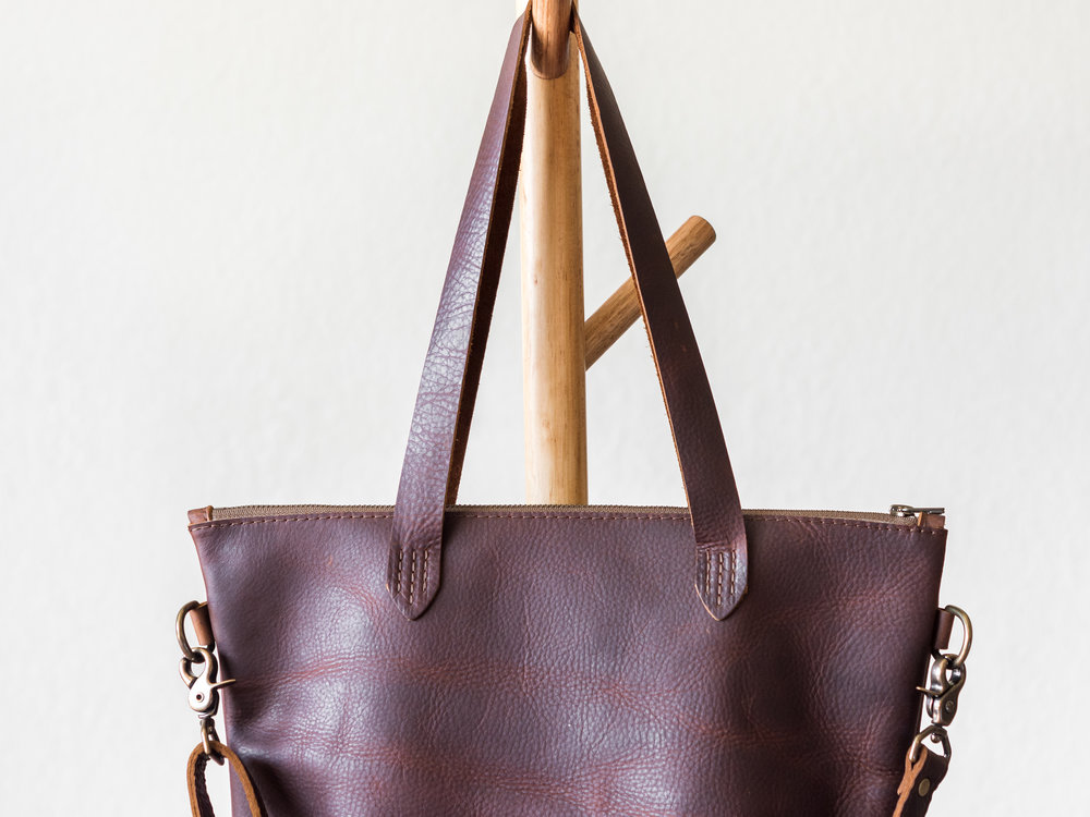 zipper tote with crossbody strap in brown1.jpg
