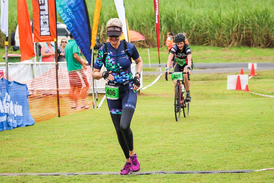 Liz Nash coming in for her transition from her 12 km trail run to the final 30 km cycle in the Zach Mack Adventure race, held annually at the Pinnacle Pub in the Pioneer Valley, close to the regional centre of Mackay in Queensland.