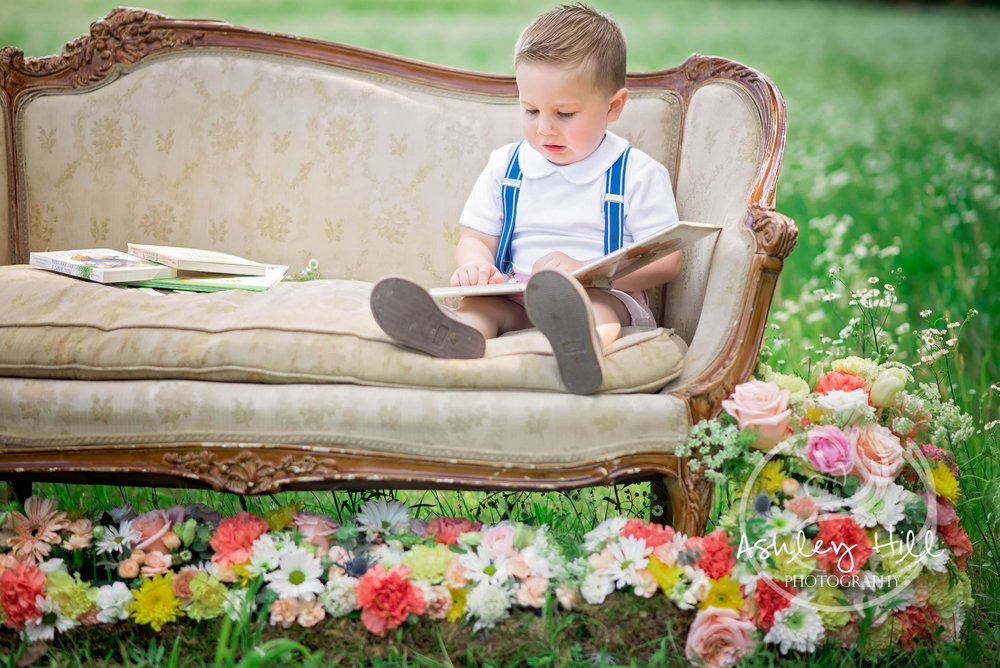 Baby boy on settee with  flowers.jpg