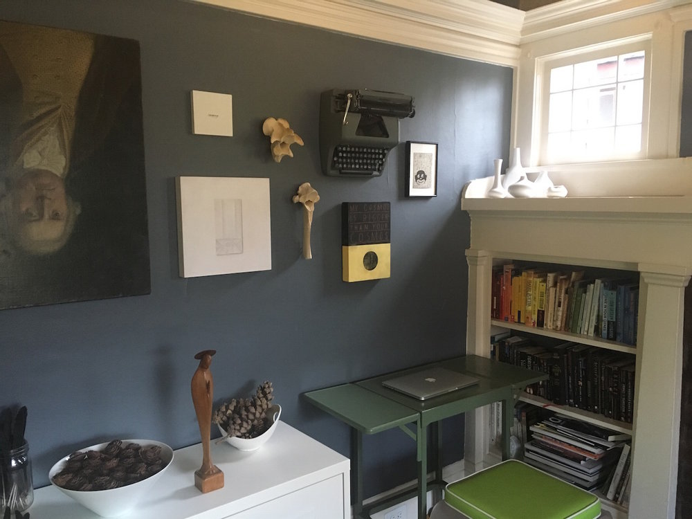 Rabin's writing space, surrounded by works from Alyson Provax, Sarah Fagan, David Bray, and Sharyll Bourroughs.