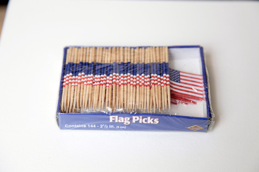 "No Picnic (144) (2016)  - Flag toothpicks, 4 ½"" x 3 ½"" x ¾"". Made in collaboration with Ross Lee Chappell"