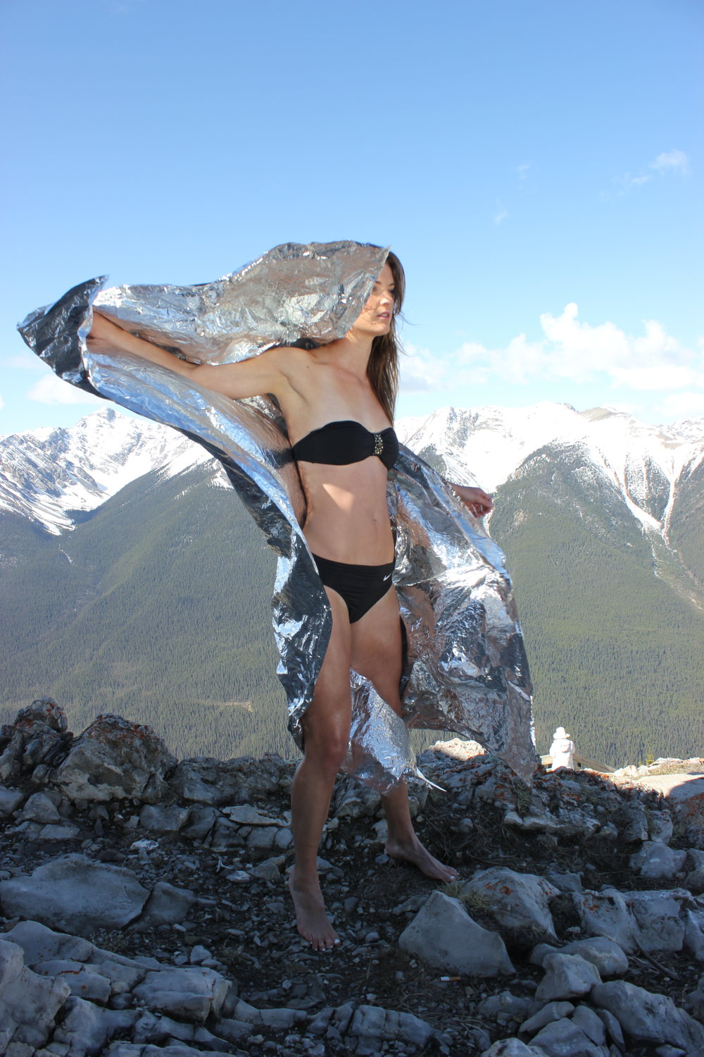 Mountain top props and Javelin athlete Rachel Machin. Banff, Alberta, Canada