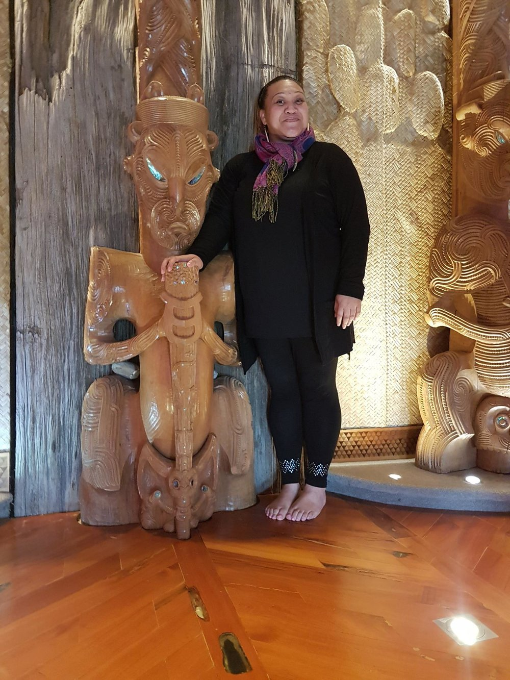 above: A pre-European Māori gardening implement, an  adze, found in the Sanctuary Mahi Whenua is embedded in the floor in front of a carving in Unitec's whare whakairo (carved meeting house) 'Ngākau Māhaki'. Jessica Aranui is the marae kaitiaki for this impressive building designed and built by Te Arawa master carver Lyonel Grant
