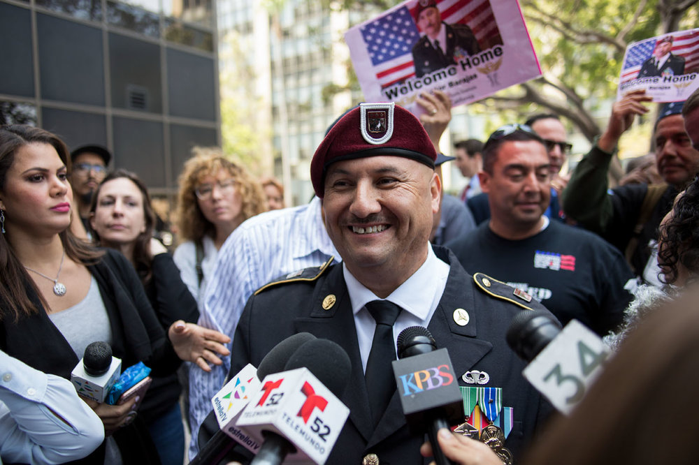 Spc. Hector Barajas speaks with the media after taking the oath as a U.S. Citizen.