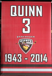 A banner in tribute to Pat Quinn