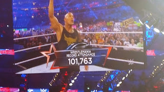 The Rock announcing an attendance of 101,763