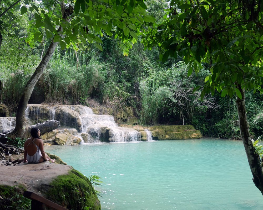 Ready to take a tip in Kuang Si Falls