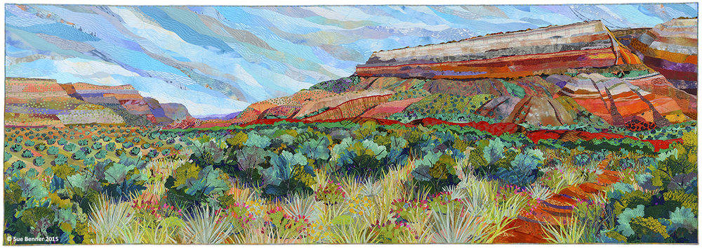 "Palo Duro Canyon: Fortress Cliff –   28"" x  84""  Art quilt:  dye and paint on silk, cotton, found fabrics, fused collage, machine quilted"
