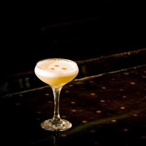 RANGOON CLUB   • 2 oz. Gordon's Dry Gin • 1 oz. Lemon Juice • .75 oz. Cream of Coconut • 1 Egg White  • 1. Combine all ingredients in a cocktail shaker and reverse dry shake. • 2. Strain into a Herbsaint rinsed coupe glass. • 3. Garnish with 3 dashes Angostura bitters.