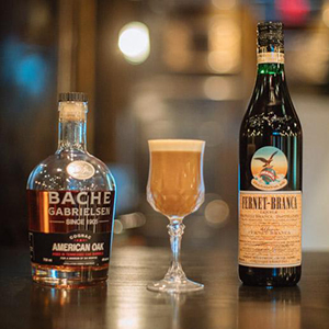33 1/3   • 1.5 oz. Fernet Branca • .5 oz. Bache American Oak Cognac • .5 oz. Aquafaba • .5 oz. Coconut Cream • .5 oz. Coke reduction  • 1. Combine all ingredients into a cocktail shaker and shake with ice. • 2. Strain into a cocktail glass. • 3. Garnish with grated nutmeg.