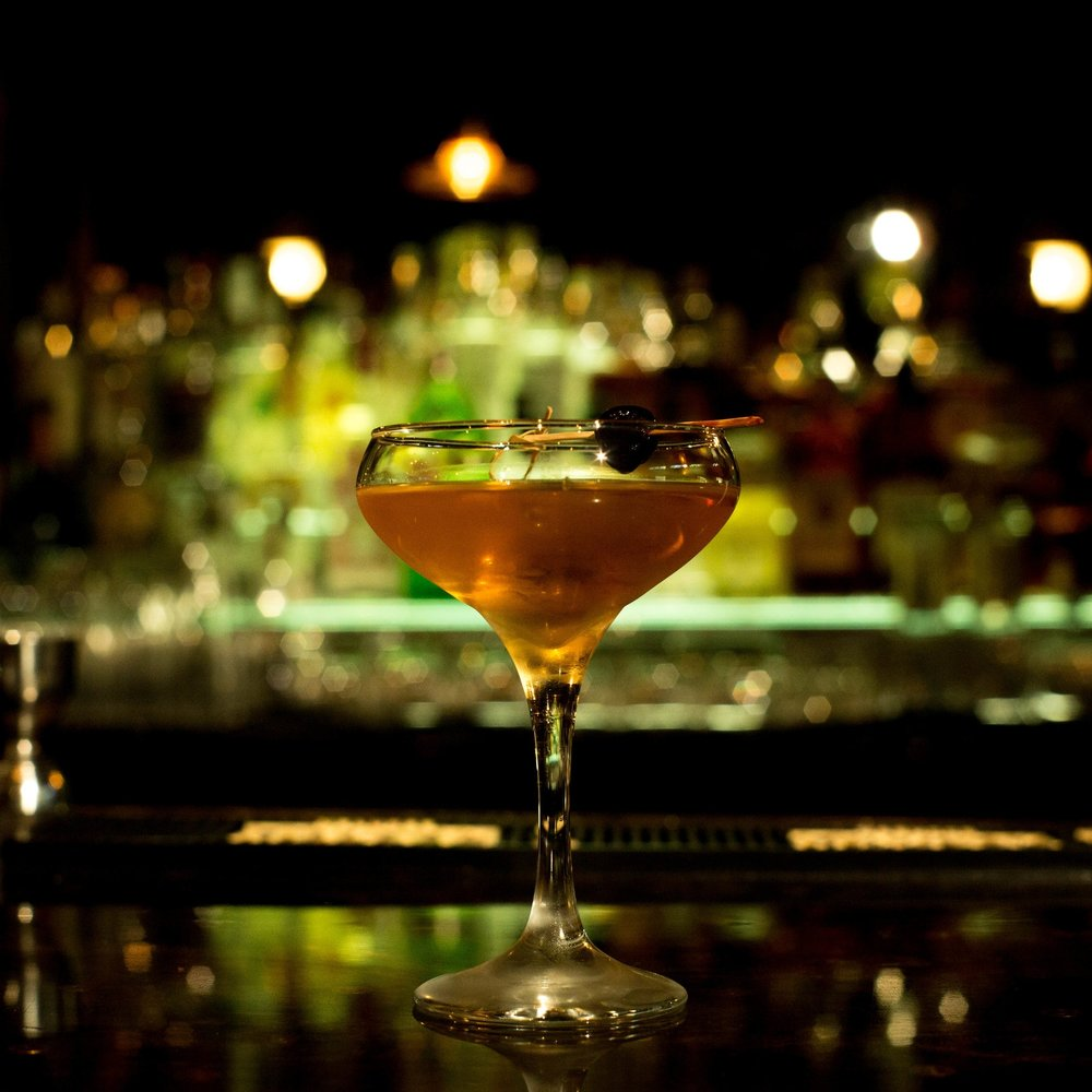 LUCKY BIRD   • 1 oz. Angostura 7 year • .5 oz. Kronan Swedish Punsch • 1 bar spoon Apricot Liqueur  • 3 dashes Bittermens Mole Bitters • 1.5 oz. Dolin Dry  • 1. Combine ingredients in a mixing glass and stir. • 2. Strain into a cocktail glass. • 3. Garnish with cherry.