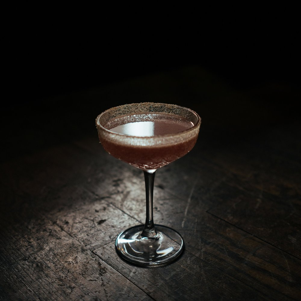 LOMAX   • 2.5 oz. La Guita Manzanilla • .5 oz. Mellow Corn • .5 oz. lemon juice • .5 oz. orgeat • .25 oz. pineapple juice • .25 oz. vanilla syrup  • 1. In a cocktail shaker, muddle 5 blue berries with orgeat and vanilla syrup. • 2. Combine remaining ingredients into a cocktail shaker and shake with ice. • 3. Fine strain into a cinnamon / sugar rimmed coupe glass.