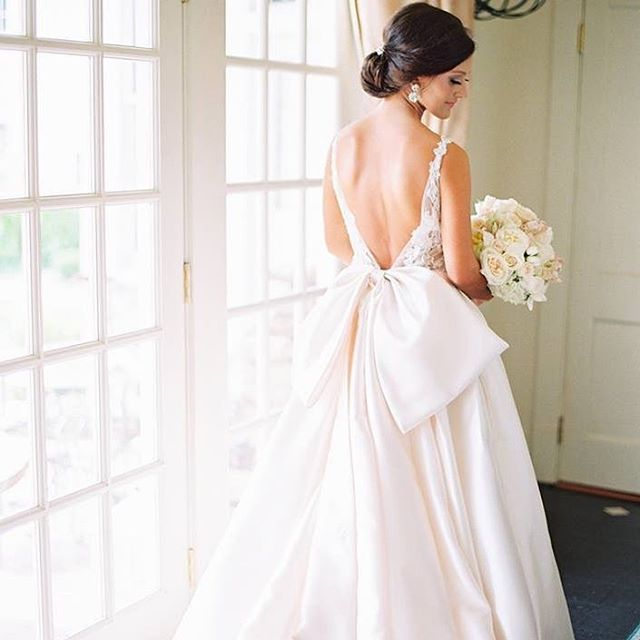 MRS enger—a true picture of being beautiful inside and out! her @lazarobridal gown totally reflected her sweet, sophisticated personality. the lace + the bow + the satin = the most stunning bridal look EVER!