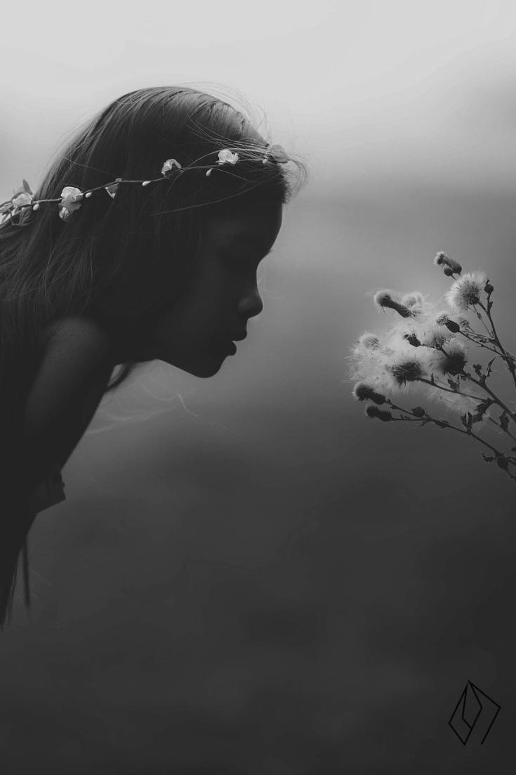 girl smell flowers.jpg