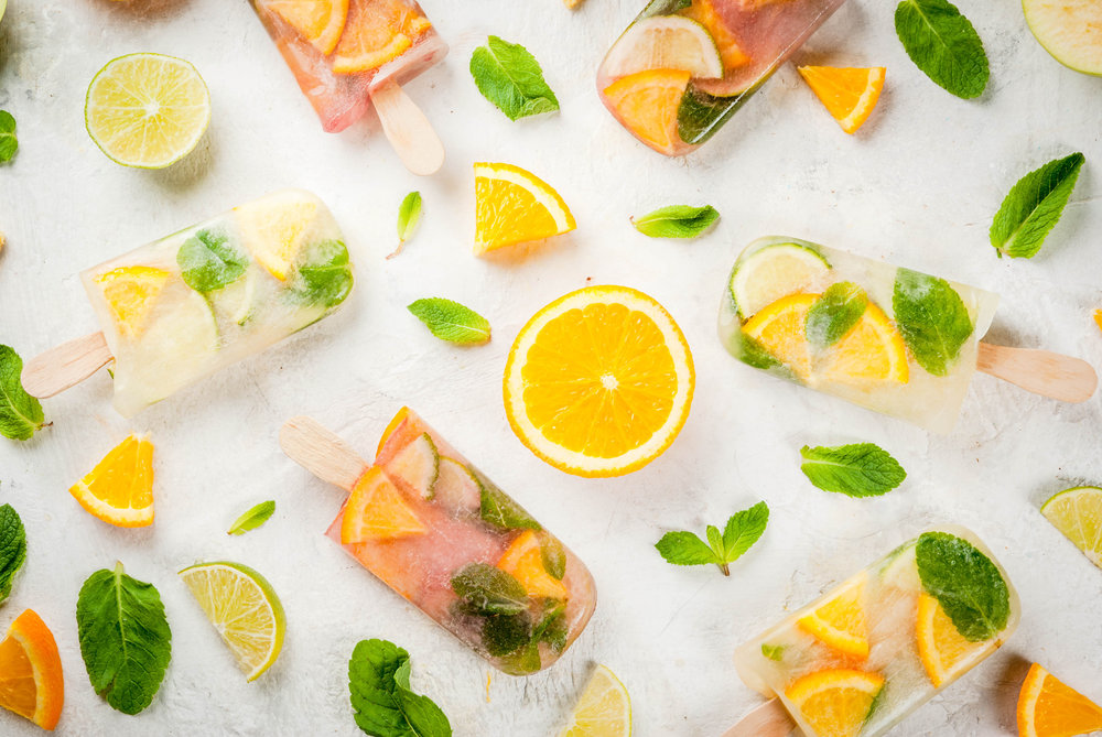 Popsicles of red, white sangria, lemonade or mojito. With oranges, lime, mint, apples..jpeg