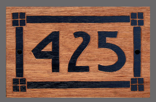 Board with Arts and Crafts border and house number
