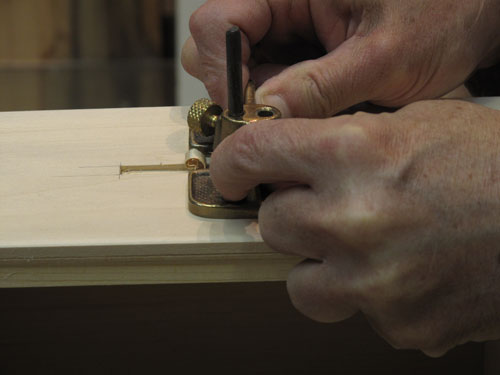 Using a small router plane to clean the bottom of a mortise- HTWW