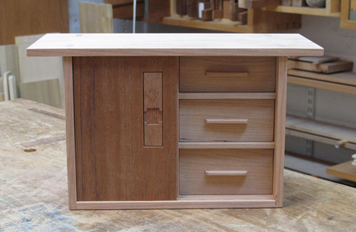 Cherry box with sliding mahogany door and 4 drawers