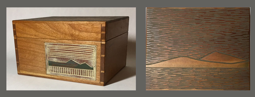 Cherry sawn-lid box with landscape carvings on front and top