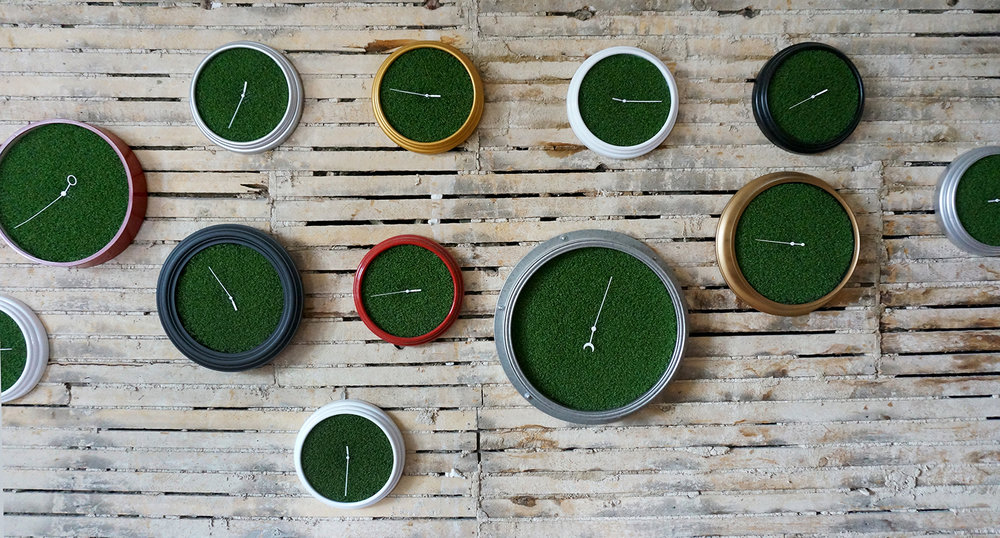 Ape_Bleakney_RoomsToLet_'Sixth Extinction (11.57)' (16), Installation (Clocks, Artificial Grass, Spraypaint, Audio), 2017.jpg