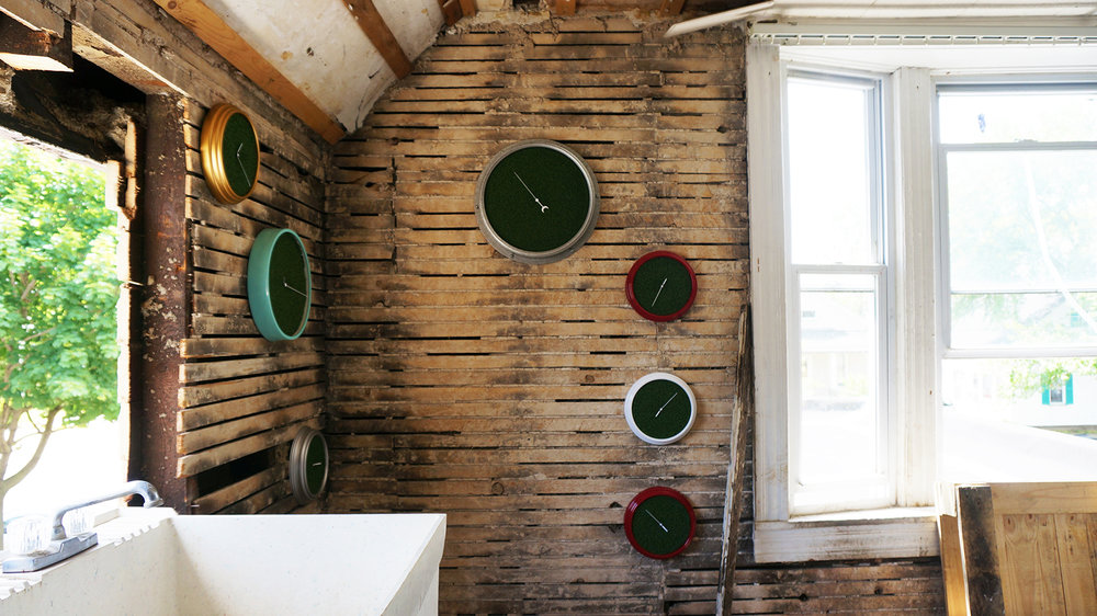 Ape_Bleakney_RoomsToLet_'Sixth Extinction (11.57)' (8), Installation (Clocks, Artificial Grass, Spraypaint, Audio), 2017.jpg