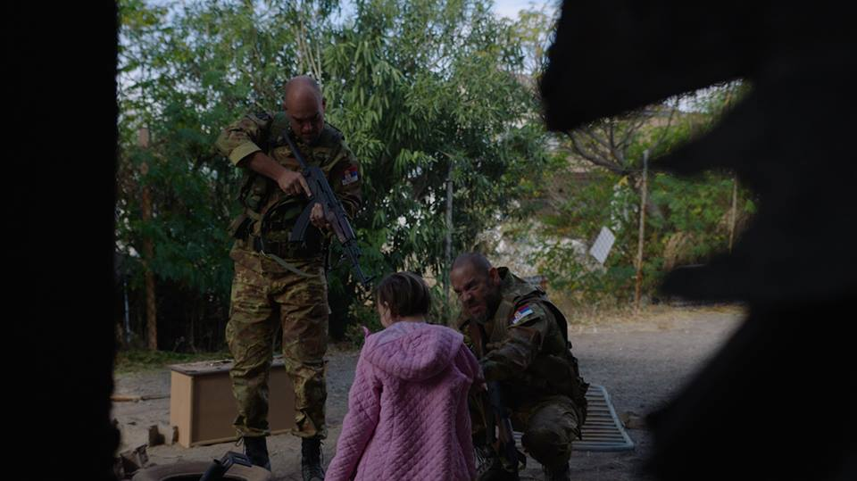 Soldiers point at Vera.jpg