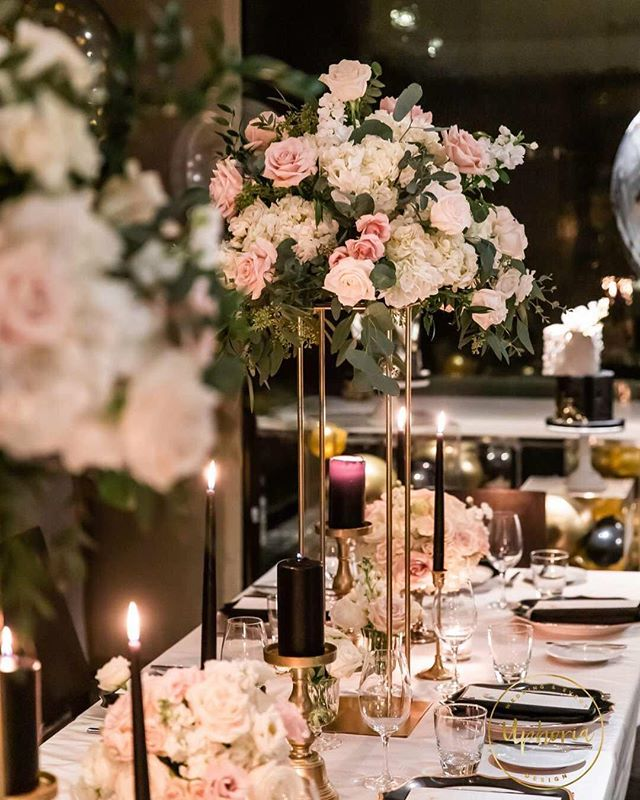 Fancy fancy centerpiece . . . . #uphoria#uphoriaweddinggs #torontobirthdayparty #torontoevents #birthday#uphoria #torontowedding #trontoplanner #torontofashion #luxurylife #luxurydinner#weddingdecor#weddingplanner #luxurywedding#eventplanning #flowerarch#centerpiece #whitewedding#wedluxe #reception#chargers#floraldecor #headtable#modern#elegant#royal