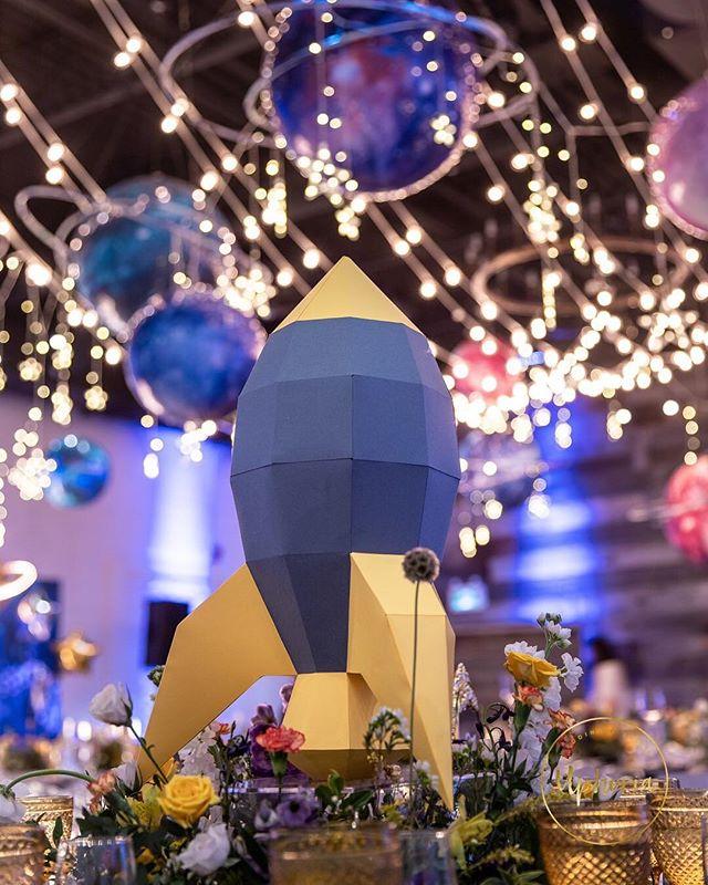 Special paper rocket centerpiece for Lucas' 100-day celebration 🎉 📷 @photographerwill . . . #uphoria#uphoriaweddinggs #torontobirthdayparty #torontoevents #birthday#uphoria #torontowedding #trontoplanner #torontofashion #luxurylife #luxurydinner#weddingdecor#weddingplanner #luxurywedding#eventplanning #flowerarch#centerpiece #whitewedding#wedluxe #reception#chargers#floraldecor #headtable#modern#elegant#royal #galaxy#star#rocket