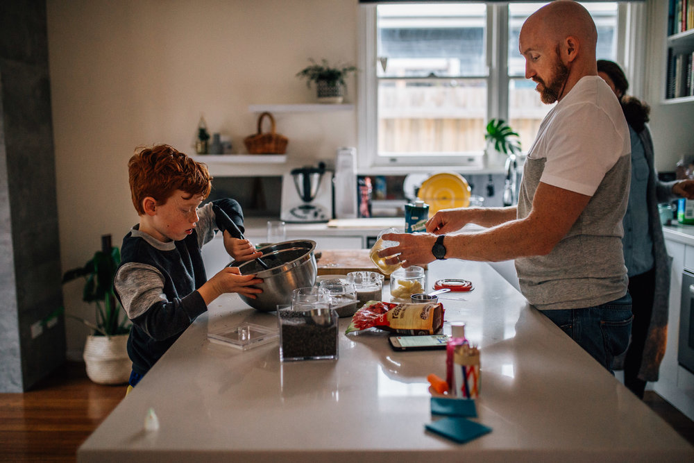 Father and son cooking.