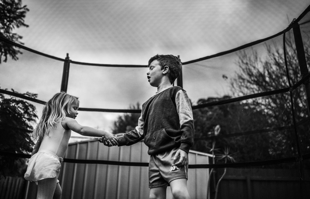 Two children on trampoline.