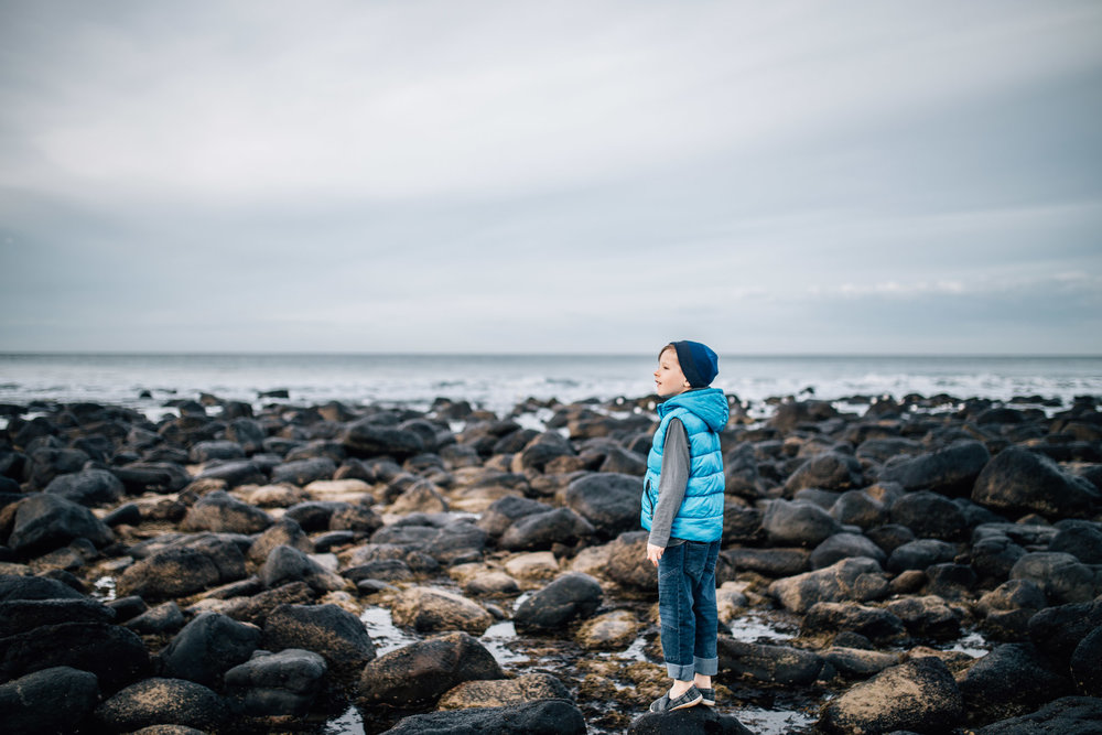 boy on the rocks at the beach (1 of 1).jpg