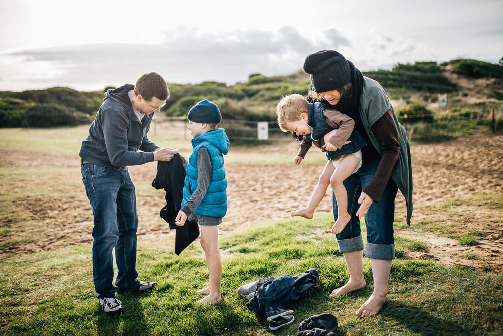 parents dressing children at beach (1 of 1).jpg