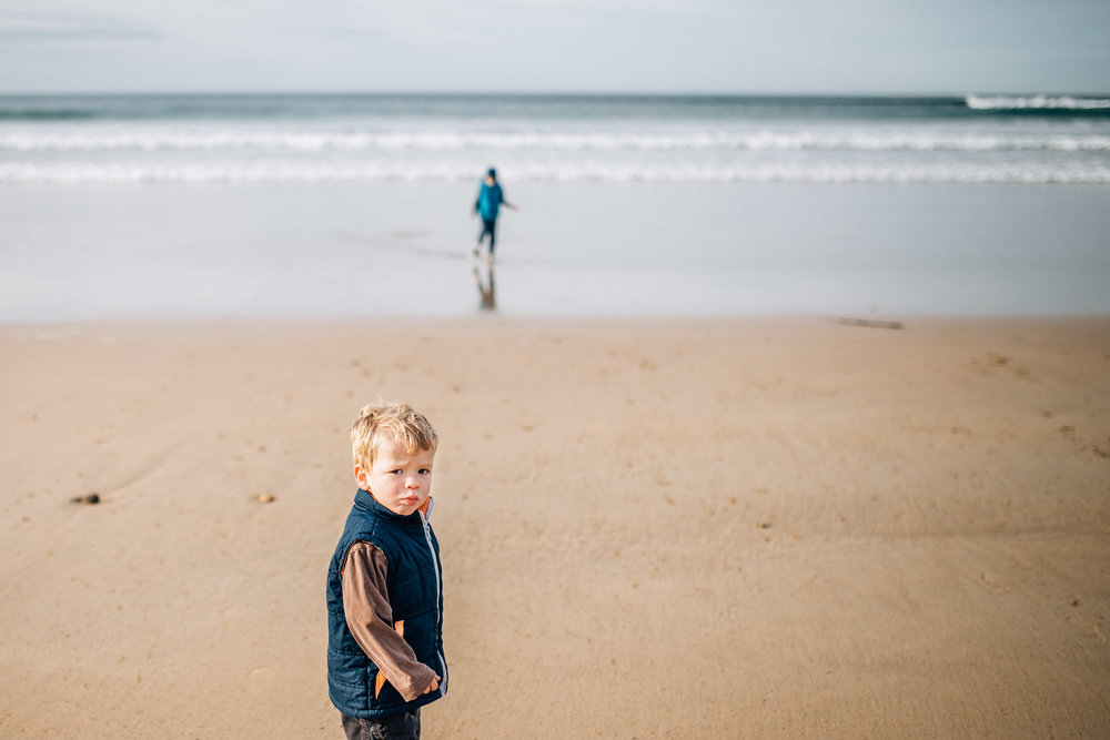 toddler boy on beach grumpy face (1 of 1).jpg