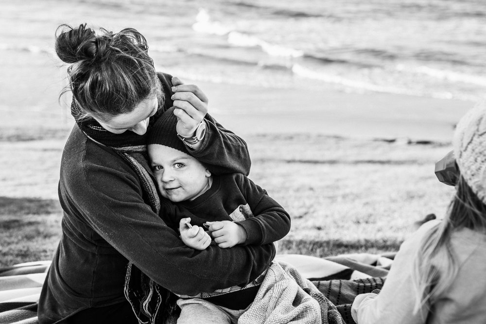mother cuddling son BW (1 of 1).jpg