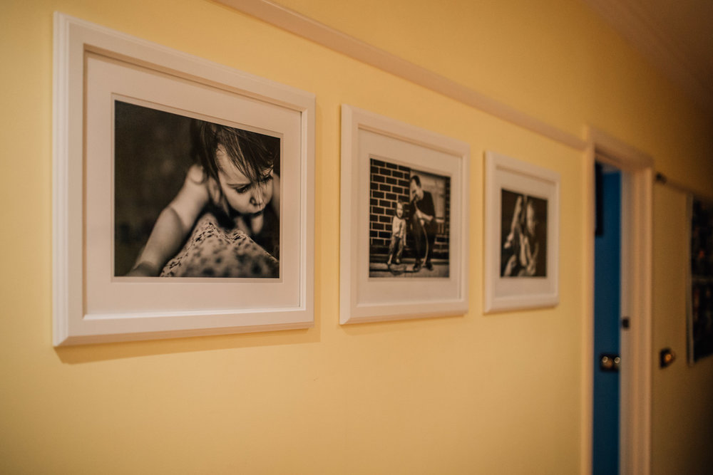 Here's one of our black and white wall galleries, located in our kitchen space.