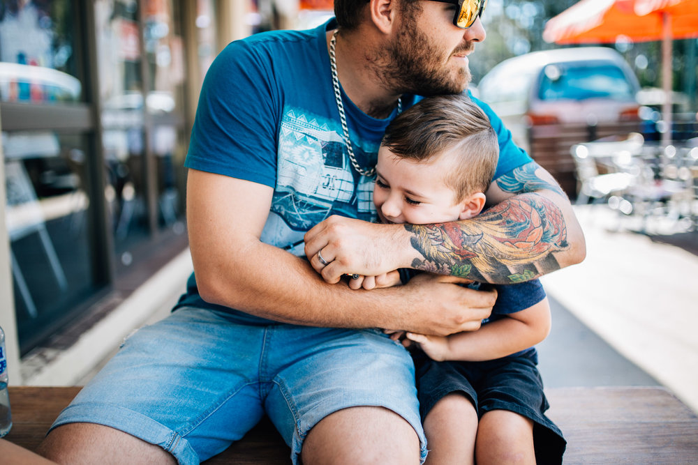 dad and son cuddling (1 of 1).jpg