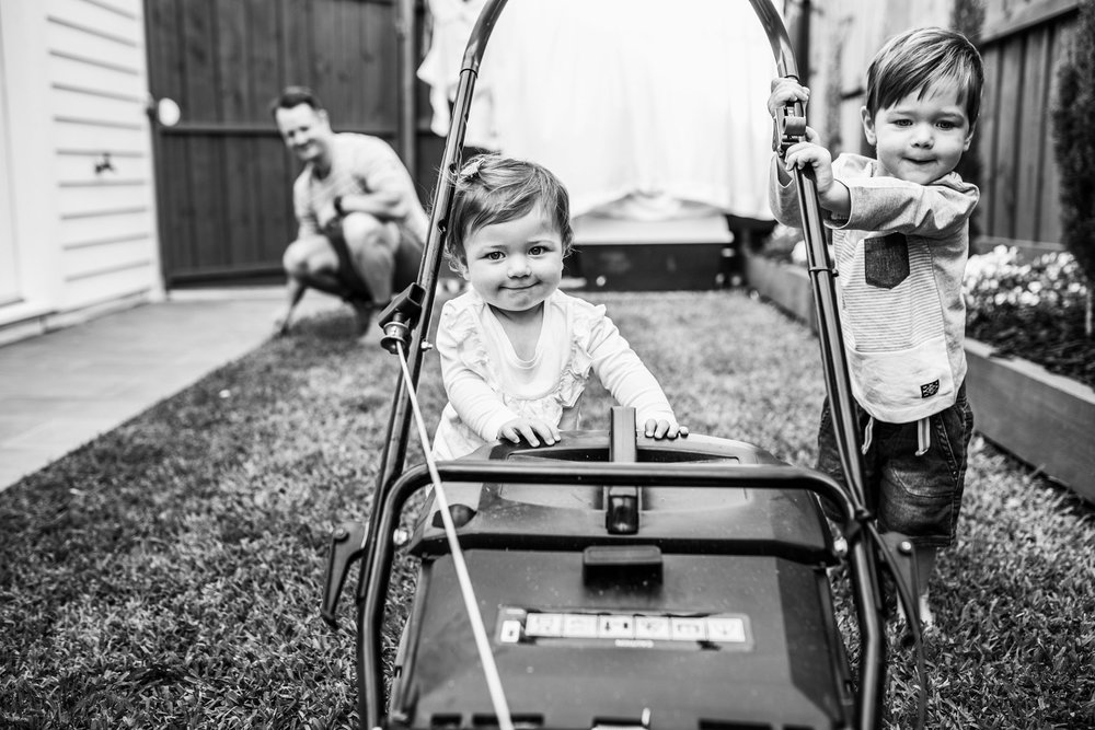 two children pushing lawn mower (1 of 1).jpg