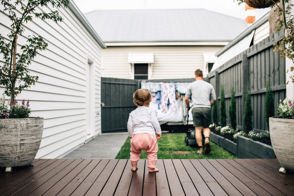 little girl watching father mow the lawn (1 of 1).jpg